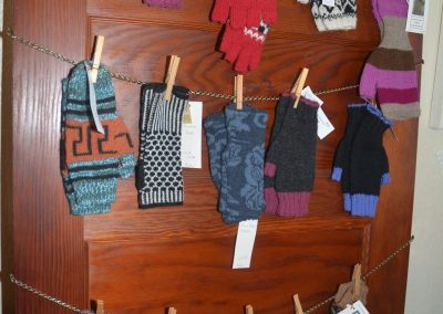 Glove display on door at Poppy's